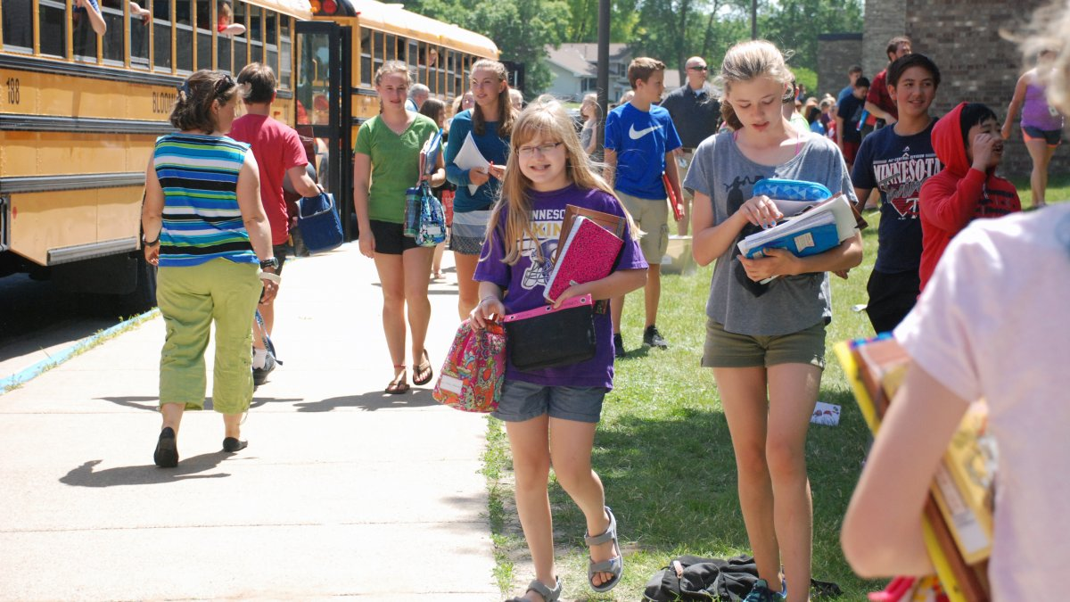 Students head to the buses after school