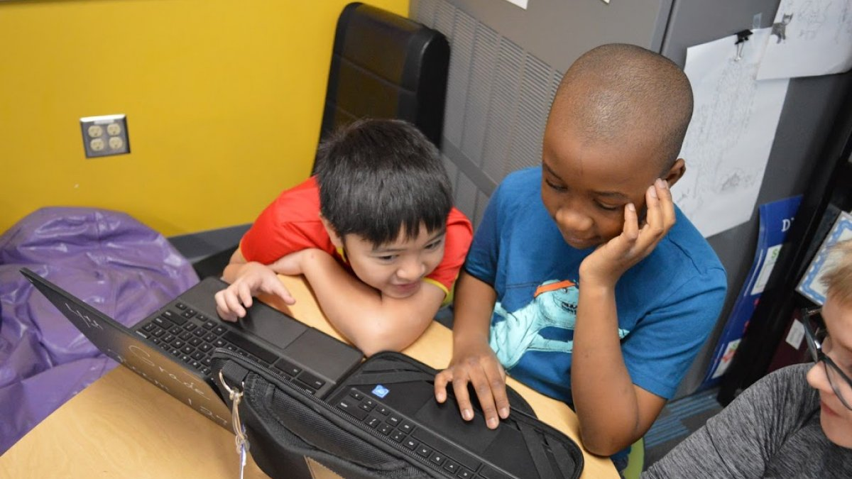 two boys working on Chromebook
