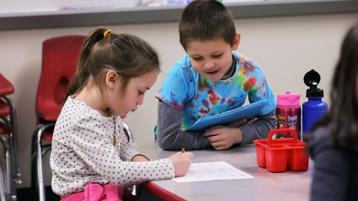 Two students work together on a worksheet