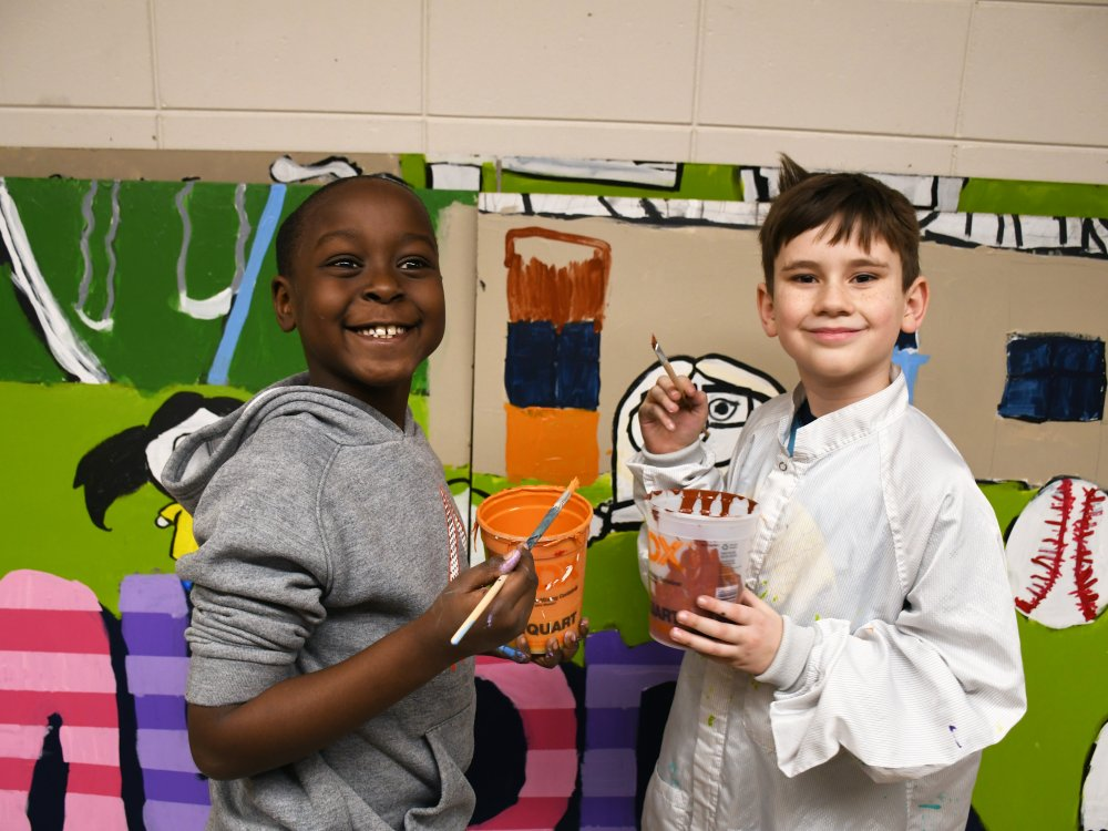 Two students painting