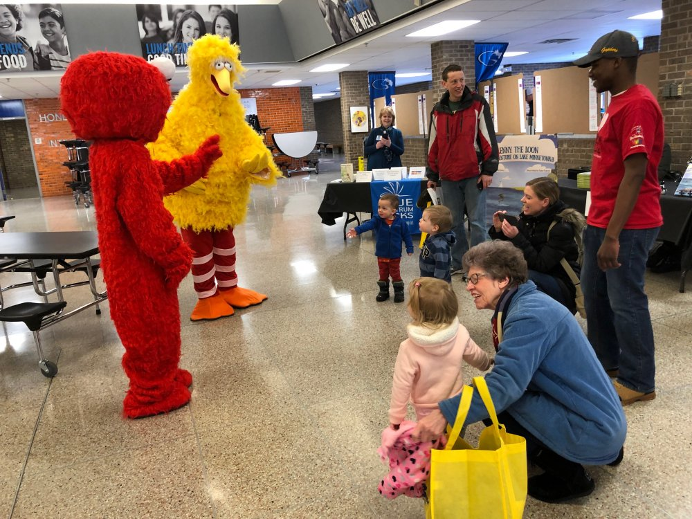 Elmo and Big Bird greet students and families