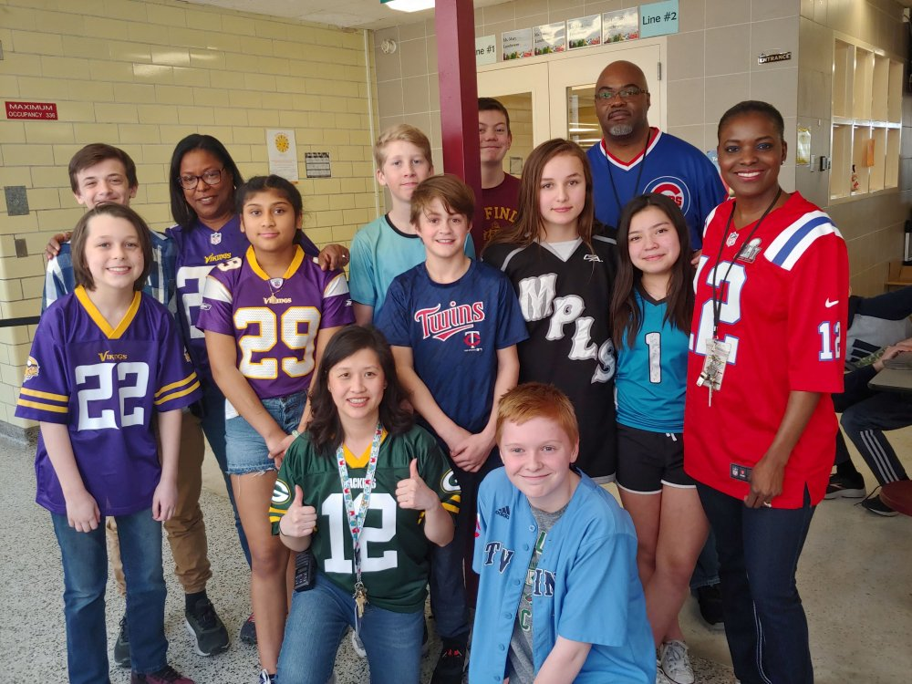 Students and staff wearing sports jerseys