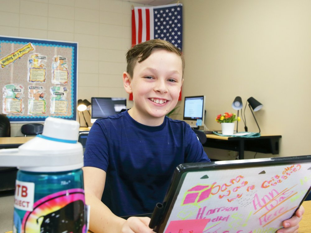 OGMS student smiling in classroom